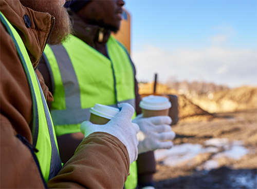 construction workers holding coffee cups
